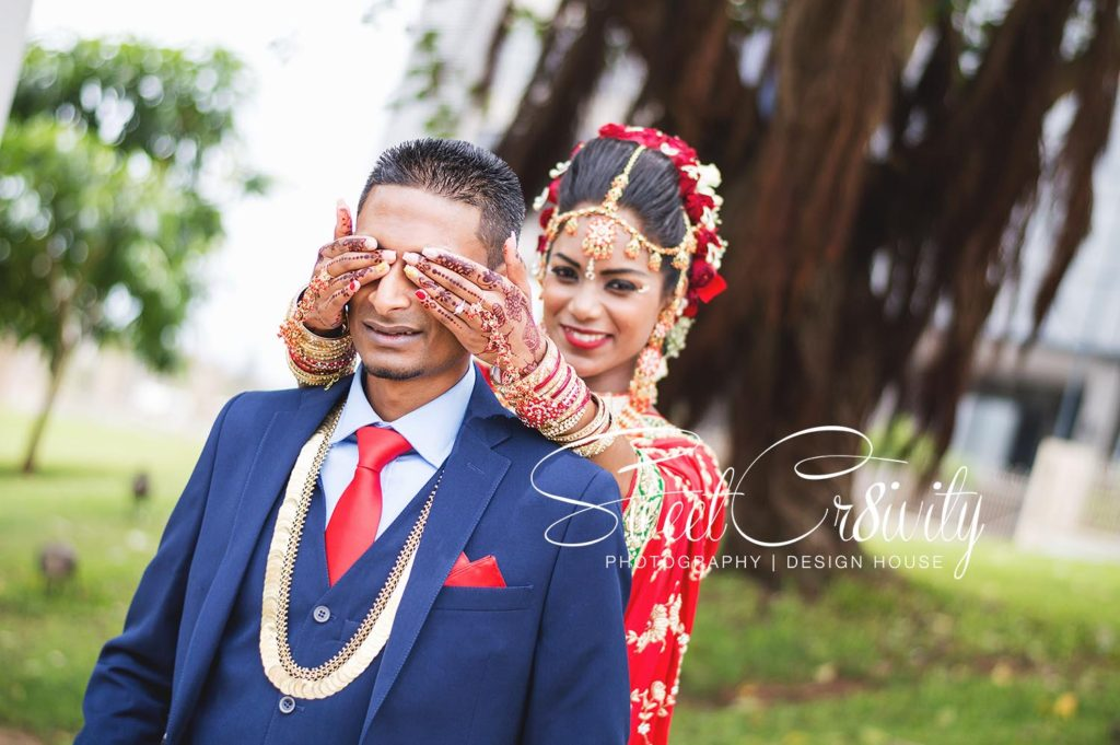 tamil wedding,chris saunders park creative shoot,bridal couple,durban wedding photographers,umhlanga,red bridal sari,long south indian plait,shree emperumal temple hall mt edgecombe,red and white roses,mala,thali,rings,prevern and lushal,elaine and aveen lutchman,toe rings,beautiful bride,love,wedding photographers durban