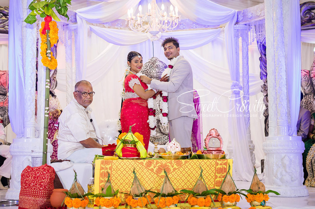 sweetcr8ivity,best durban wedding photographers, elaine and aveen lutchman, we love weddings, south indian bride, red sari, thali, Kharwastan Temple Hall,snap that, videography, cas weds sam, traditional, mehendi, its official