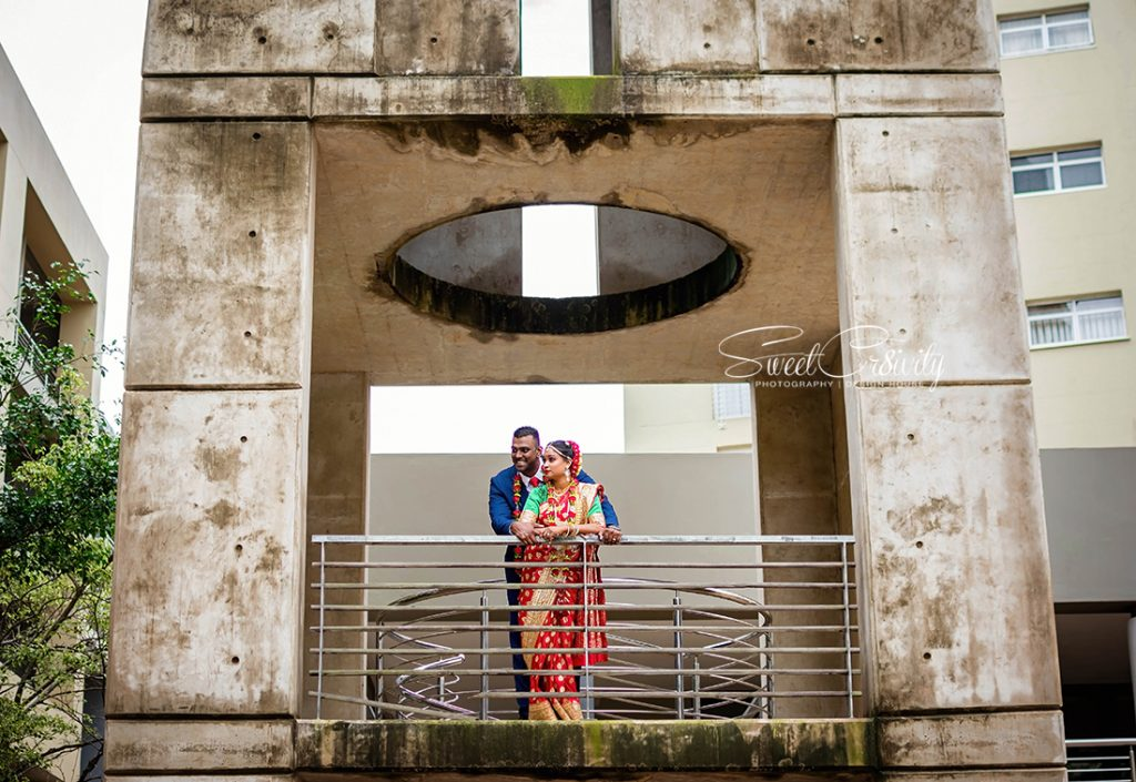 south indian wedding, best durban wedding photographers, sweetcr8ivity, elaine and aveen lutchman, umngeni road temple, intimate moments, creativity, colors, indian, happiness, love, creative shoot, red sari, dapper suit, navy blue,beauty,sunlight,perspective,groom,bride,view from the top