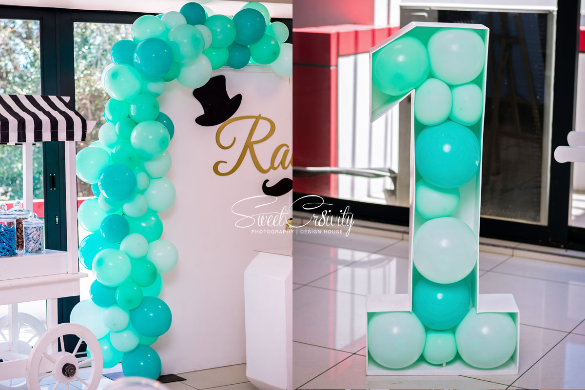 raees turns 1, sweetcr8ivity,the polkadot company, aveen and elaine lutchman, little man, themed birthday party, umhlanga, overport,best durban photographers, Nikon, the exotic conference venue, mumtaz cocoa, gift bags,, themed cookies, fancy, creative, mo magic, donuts, balloons, candy cart