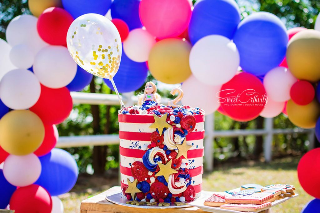 gold star, born in the usb, world globe, usa themed birthday party, balloon arch, little firecracker, myra, the polkadot company, sweetcr8ivity, one in melon, barbie, cookie countess, sweetcr8ivity, aveen and elaine lutchman, best kids party photographers