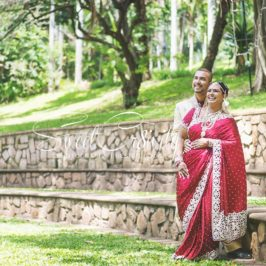 1 year wedding anniversary,durban botanical gardens,durban wedding photographers,red sari,sweetcr8ivity,elaine and aveen lutchman,will always be the 1 white rose amongst the red ones,love story,happiness,laughter,fun,creative,ring shot,couple goals,he always makes her smile,lace umbrella,creative photo shoot
